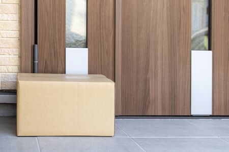 Image of leaving parcel delivery luggage at unattended entrance Stock Photo