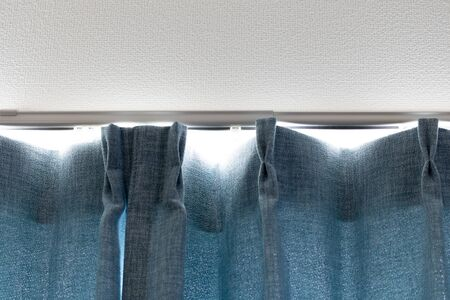 Image of light entering through the gap between curtains Stock Photo