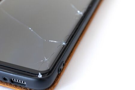 Close up of a cracked smartphone protective glass