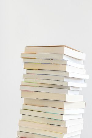 Pictures of many books stacked Stock Photo
