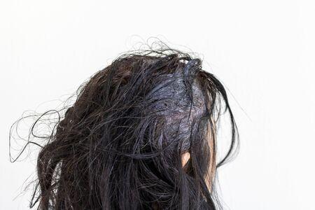 Head of an elderly woman dyeing gray hair