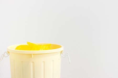 Yellow 45L trash can on white background Foto de archivo