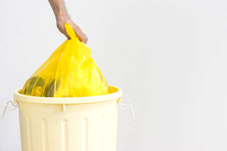 Yellow 45L trash can and man's hand