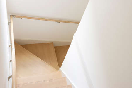 Stairs in a wooden house taken from above