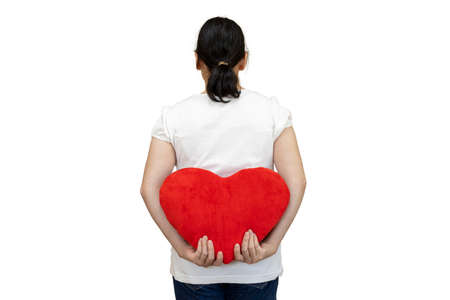 Back view of a woman with a heart cushion hidden on her back