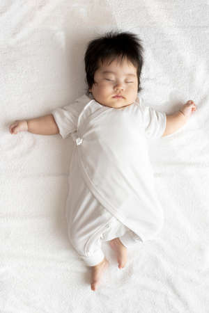 Whole body of sleeping baby, girl, 4 months old, years old