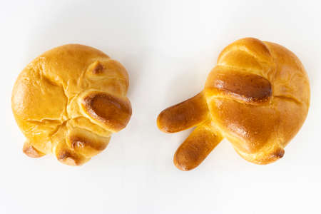 Photo of rock-paper-scissors hand-shaped bread