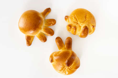 Photo of rock-paper-scissors hand-shaped bread