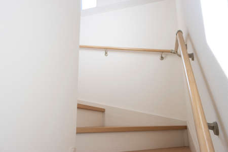 The stairs of a wooden house with sunlight