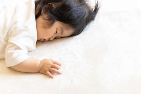 Baby sleeping prone (0 years old, 9 months old, Japanese, girl)