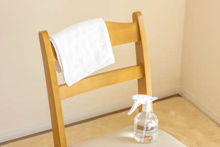 Towel and alcohol spray. Image of disinfecting chairs with alcohol
