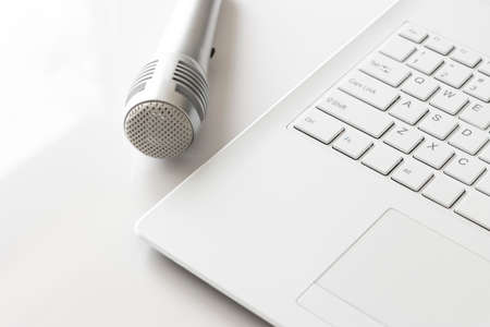 Laptop and microphone. Digital device Stock Photo