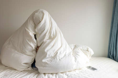 A man wearing a futon. Hikikomori image Stock Photo