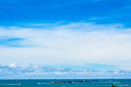 Blue sea and blue sky. Boats in the sea. Wind waves in the sea.