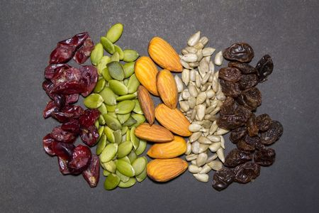 amalgamate: Trail mix on the black background.