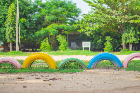 Colour of the car wheels on a lawn with sunlight.