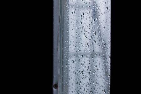 soppy: Raindrops on glass during the rainy season. Stock Photo