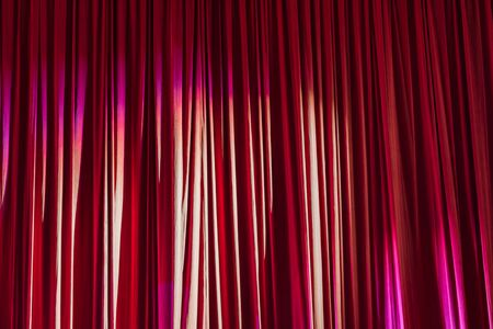 Red curtain and lights in the theater before the show. Stock Photo