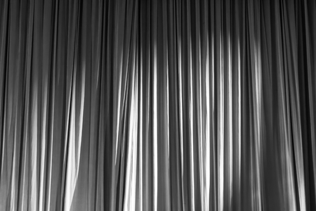 notable: Black and white curtains and spotlight in the Theater between shows. Stock Photo