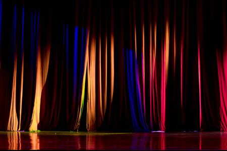 finesse: Red curtains and the spotlight in the Theater between shows. Stock Photo
