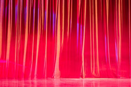 Red curtains and motion in the Theater between shows.