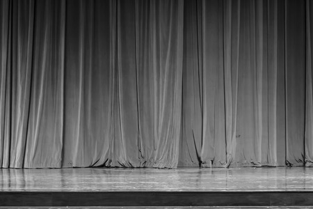 finesse: Black and white curtains and spotlight in the Theater between shows. Stock Photo