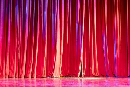 notable: Red curtains and the spotlight in the Theater between shows. Stock Photo