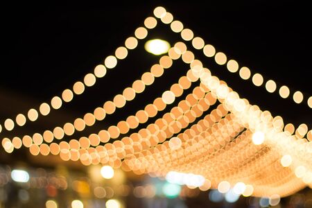 night out: Out of focus with bokeh of light in the night of the festival.