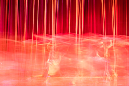 finesse: Red curtains and motion in the Theater between shows.