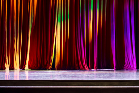 comedy show: Red curtains and the spotlight in the Theater between shows. Stock Photo