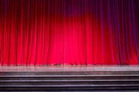 Curtains and the stage parquet with stairs in theater with colorful lighting.