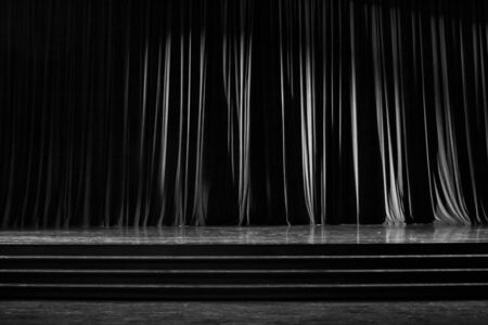 notable: Black and white  curtains and the stage parquet with stairs in theater.