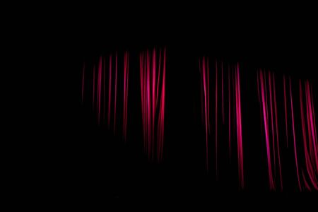 darkness: Red curtains with the darkness that still have light shining. Stock Photo