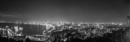 land development: Panorama  black and white cityscapes of pattaya in the night and the city is business growth.