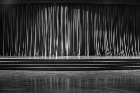 Black and white  curtains and the stage parquet with stairs in theater.