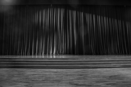 finesse: Black and white  curtains and the stage parquet with stairs in theater.