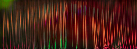 Red curtains panorama closed and the lights to a scene.