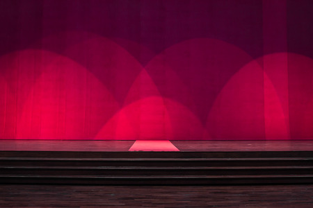finesse: Stage wood with carpet in the middle and cover red curtains in a theater. Stock Photo