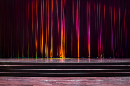 Stage wood with ladder and red curtains in a theater. Stock Photo