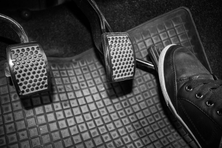 Foot while driving pedal to control the speed of the drive. Banque d'images - 120090706