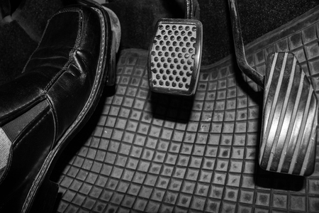 Foot while driving pedal to control the speed of the drive. Banque d'images - 120090713