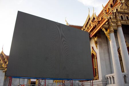 LED screen located at the temple in Thailand. LED monitor with the event or ceremonies. Stock fotó