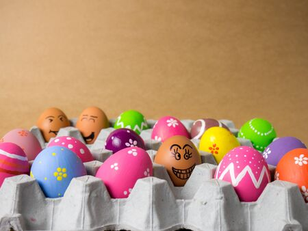 Easter eggs in a panels paper on the brown background. Easter egg in the panels paper painting with colorful during the Easter and brown background.
