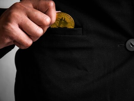 Gold bitcoin was placed in the black suit of business woman had been excavated on the internet.