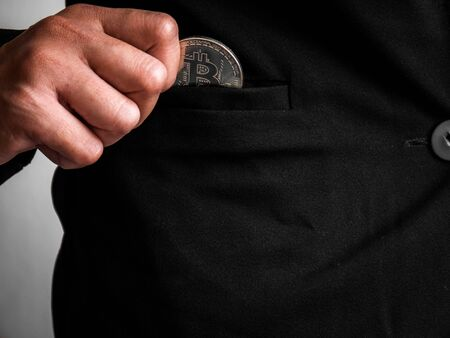Silver bitcoin was placed in the black suit of business woman had been excavated on the internet.