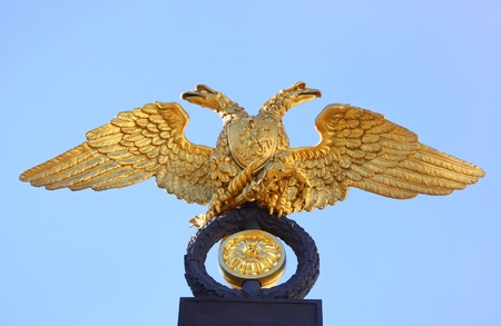 Russia arms with double-headed eagle on  blue sky background photo
