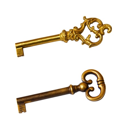 golden key: Set of old key with golden tones isolated on white