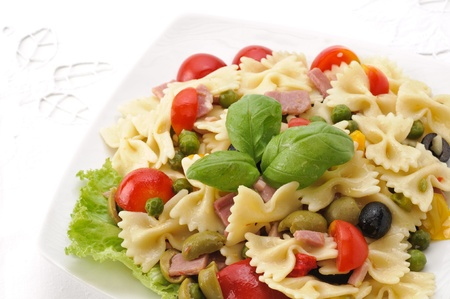 pasta salad: farfalle with vegetables and ham - pasta salad Stock Photo