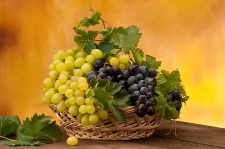 white and black grape in a basket photo