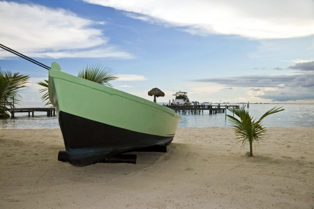 A boat in a Beach of Isla Mujeres, Mexico photo